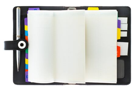 open diary: Personal black organizer with pen.