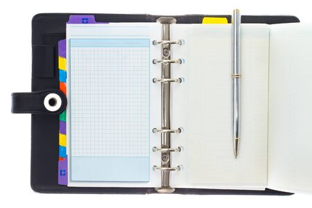 Personal black organizer with pen. photo