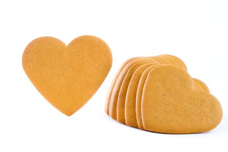 Gingerbread hearts isolated on white photo