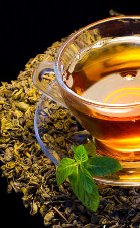 english tea: Cup of english green tea with mint