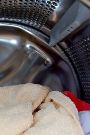Towels in an open washing machine photo