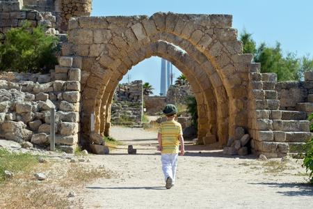 ancient israel: Little boy walks in Caesarea. Israel
