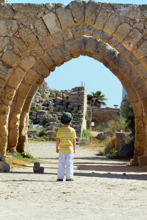 Little boy walks in Caesarea. Israel photo