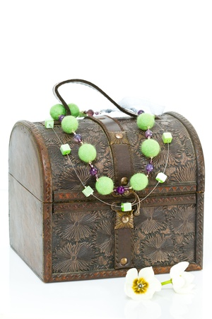 Antique old wooden jewelry box with necklace photo