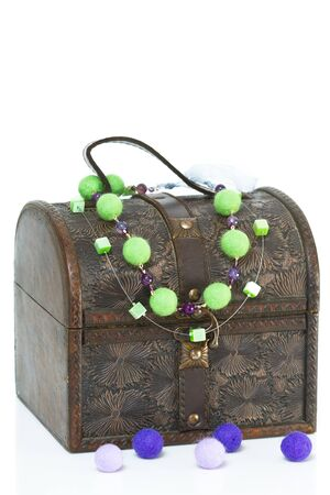 antique jewelry: Antique old wooden jewelry box with necklace