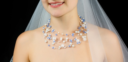 pearl necklace: Jewelry on the neck of bride . Studio shot with black background.