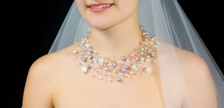 diamond necklace: Jewelry on the neck of bride . Studio shot with black background.