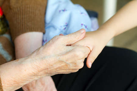 Grandmother holds the hand of his grandson Stock Photo - 13589915