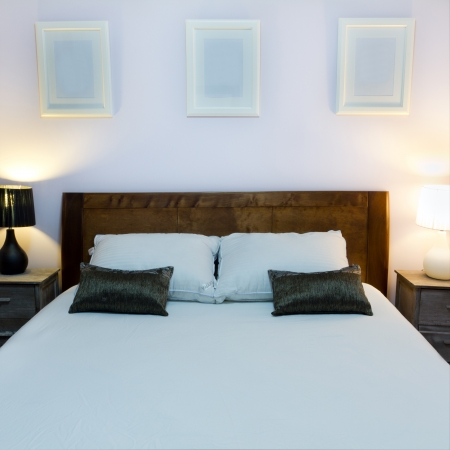 Bedroom with furnishings in a new house Stock Photo - 13957878