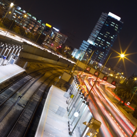 Highway and railway station with road traffic in Tel Aviv at night Stock Photo - 14438351