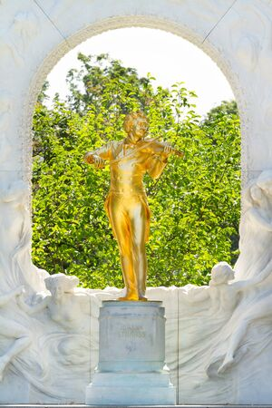 Golden statue of Johann Strauss in Vienna