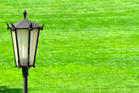 Street lamp on the grass background photo