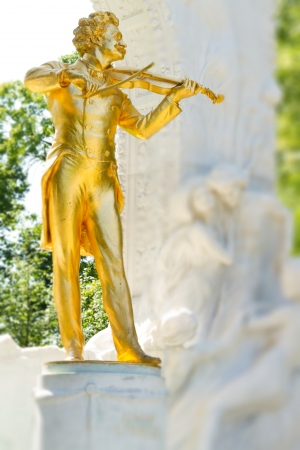 Golden statue of Johann Strauss in Vienna photo