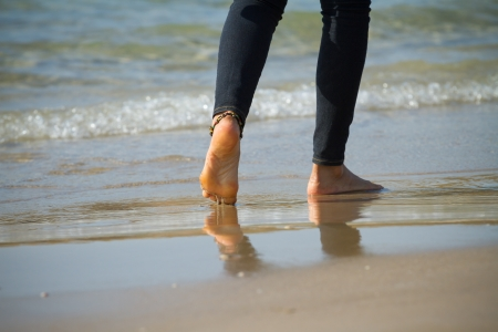Young woman walking on a beach  photo