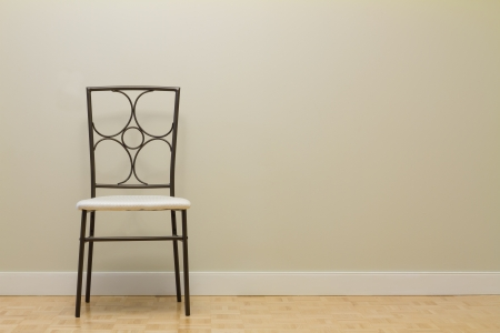 lifestyle dining: Chair against wall in a new apartment Stock Photo