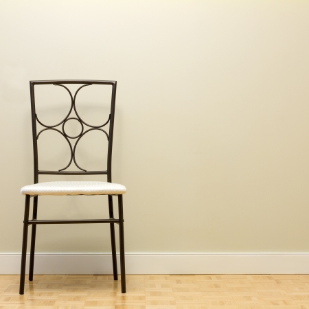 dining room: Chair against wall in a new apartment Stock Photo