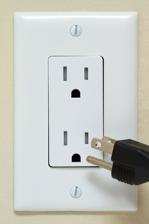 Electric cable in Electrical Outlet on the Wall photo