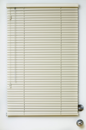 Close Metal Blinds with drawstring on the door photo
