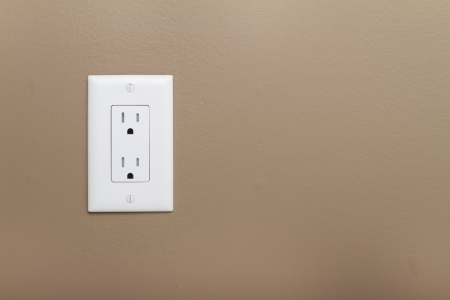 ELECTRICAL OUTLET: Household Electrical Outlet  on wall. Power 110v  Stock Photo
