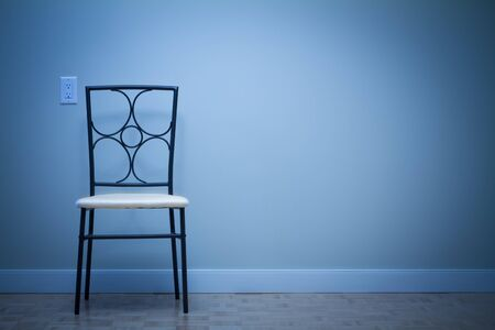 Chair against wall in a new apartment Stock Photo - 16116435