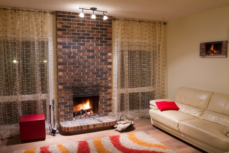 Interior design of living room in a new house with fireplace Stock Photo - 16116441