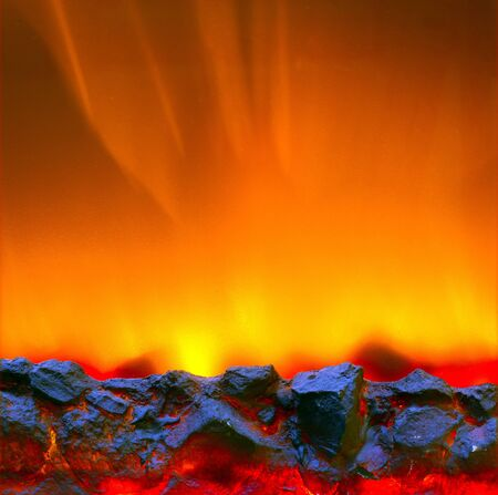 Electric fireplace with a burning coals and red-orange background Stock Photo - 16172894
