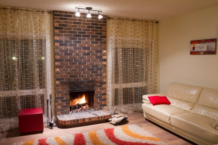 Interior design of living room in a new house with fireplace photo