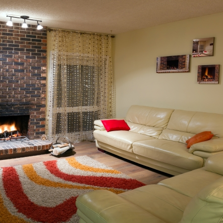 Inter design of living room in a new house with fireplace Stock Photo - 16519843