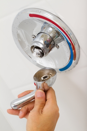Broken Shower faucet cold and hot water in the bathroom Stock Photo - 16637571