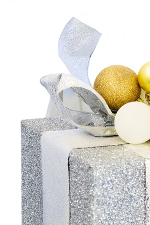 Christmas gift tied with a bow and balls isolated on a white background. photo