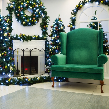Christmas living room with fireplace , Christmas tree and Santa s chair