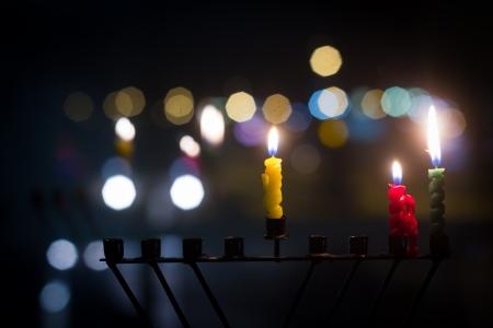 channukah: Beautiful candles and hanukkah menorah with defocus background