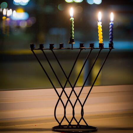 Beautiful candles and hanukkah menorah with defocus background Stock Photo - 16849879