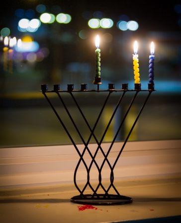 Beautiful candles and hanukkah menorah with defocus background Stock Photo - 16849891