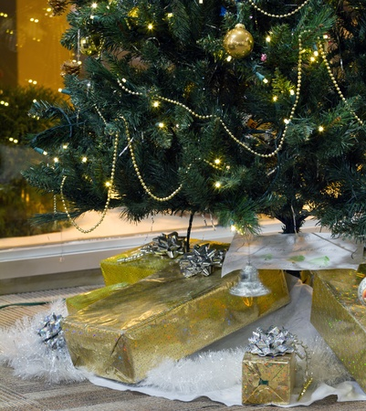 mantelpiece: Decorated Christmas tree and boxes with gifts Stock Photo