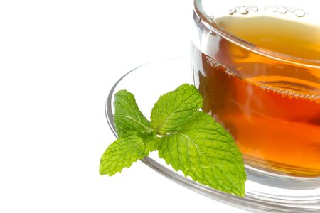 english tea: Tea cup with mint leaves on a white background Stock Photo