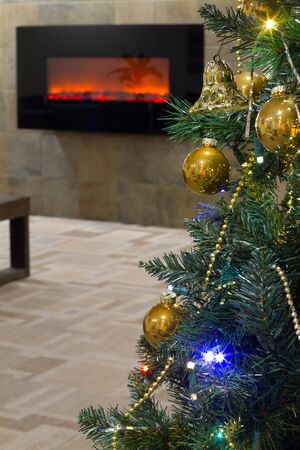 Decorated Christmas tree interior  with fireplace photo