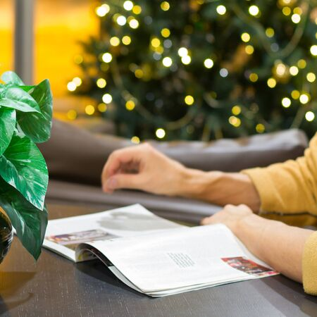Man reading a magazine at Christmas Stock Photo - 17066426