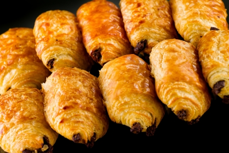 Tasty and fresh croissant on black background photo