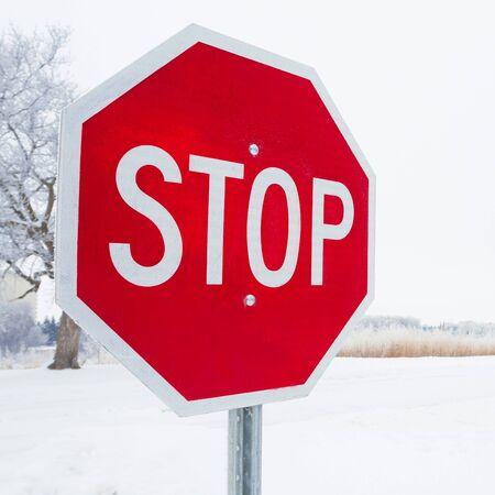 Stop road sign in snowy day in winter. Canada photo
