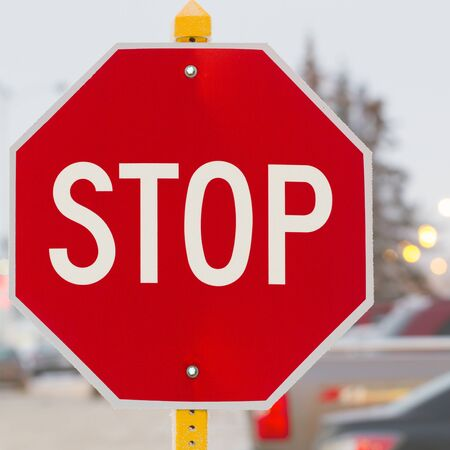 stop time: Stop road sign in snowy day in winter. Canada Stock Photo