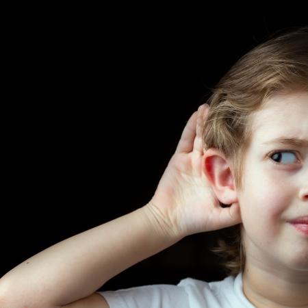 Boy Trying to hear something photo