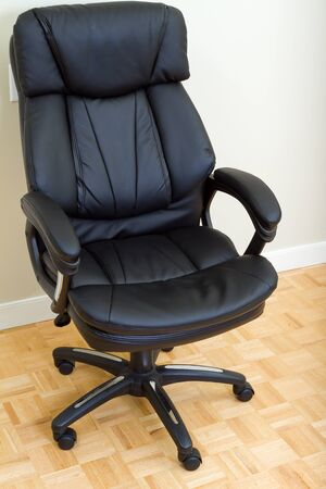 Black Leather chairman chair in office Stock Photo - 17360930