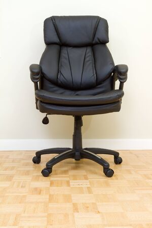Black Leather chairman chair in office Stock Photo - 17360929
