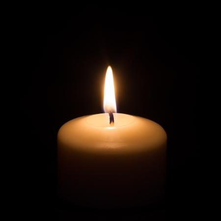 Candle on black background photo