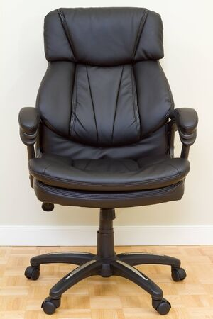 Black Leather chairman chair in office Stock Photo - 17411275