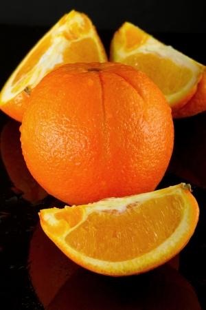 Orange Fruit in black background photo