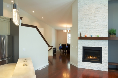 Interior design of modern Living room with fireplace in a new house photo