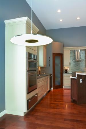 fridge lamp: Interior design of modern kitchen  in a new house