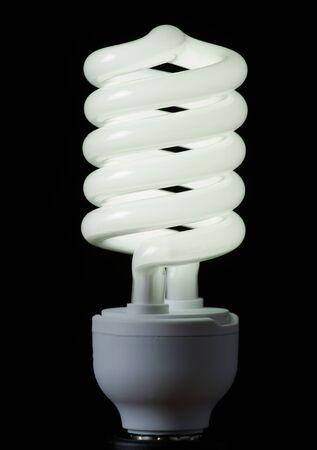 resourceful: Energy saving lamp on black background